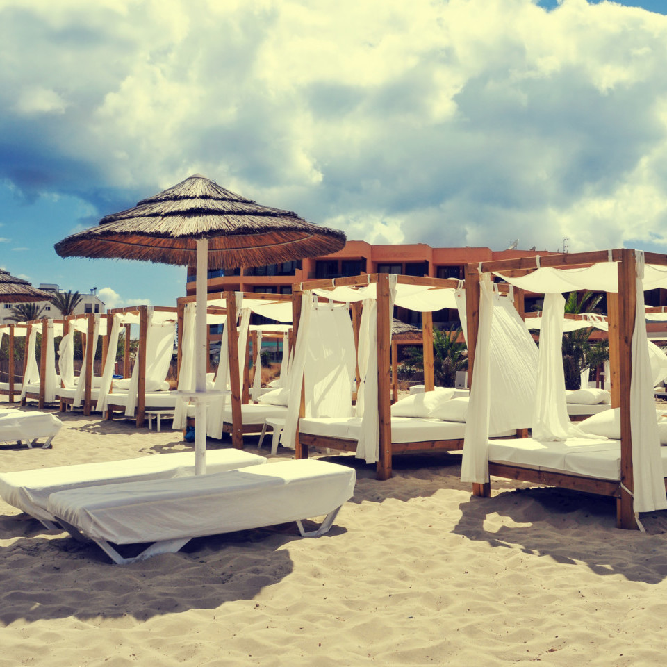 beds and sunloungers in a beach club in Ibiza, Spain
